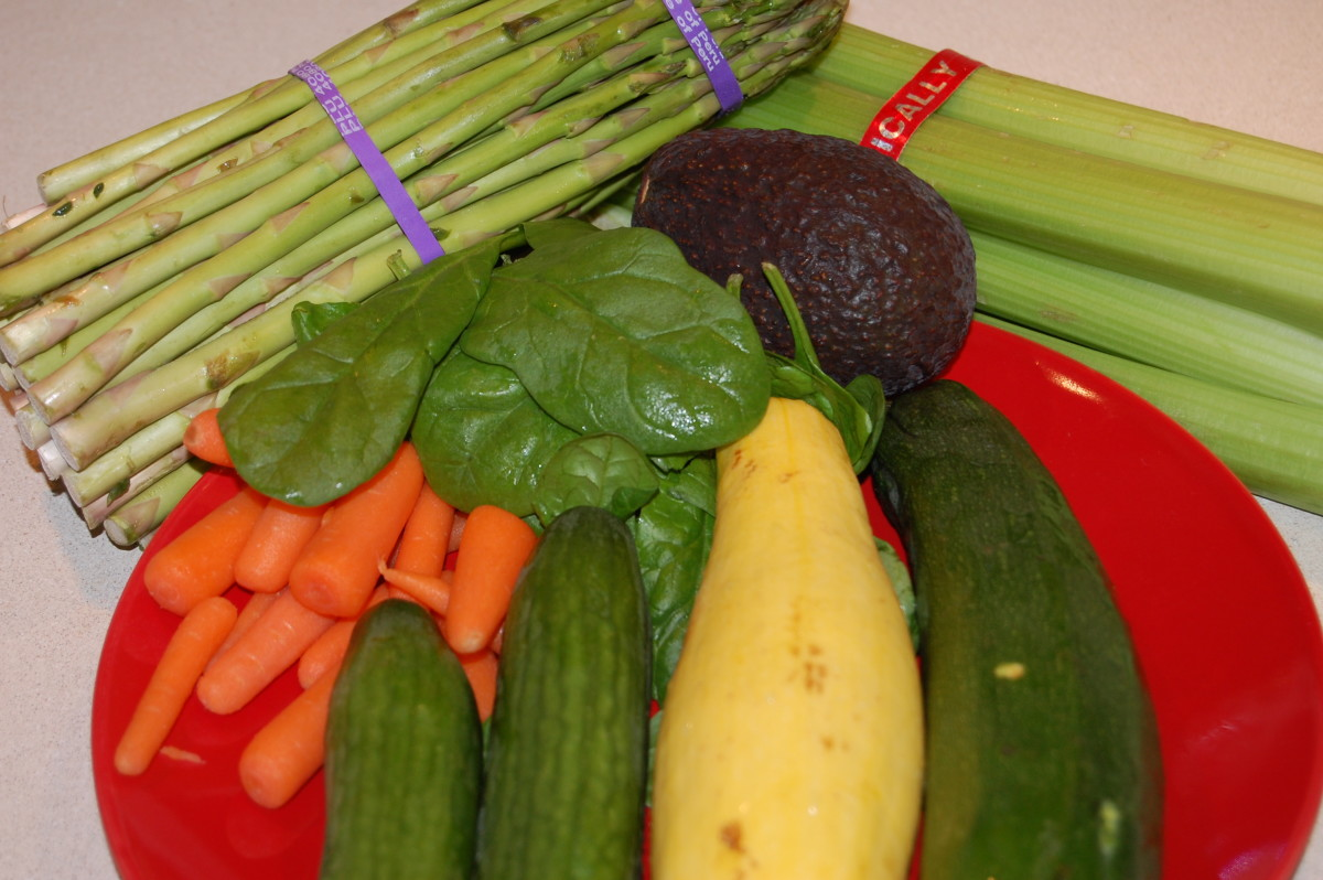 Assorted fresh vegetables:  asparagus, carrots, spinach, avocado, cucumbers, yellow squash, zucchini, celery
