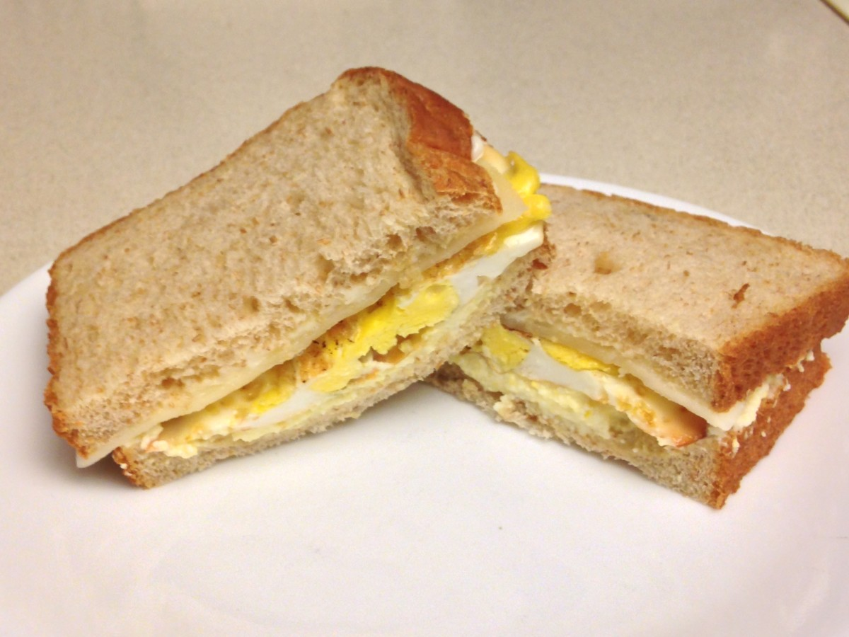 Egg salad, fried egg and provolone sandwich