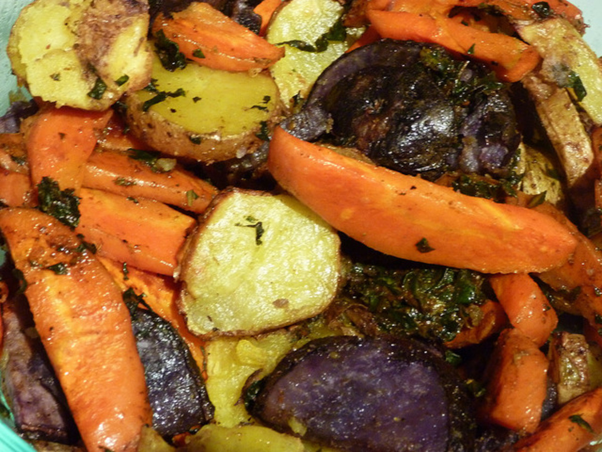 Assorted root vegetables:  carrots, sweet potatoes, potatoes, beets, purple onion
