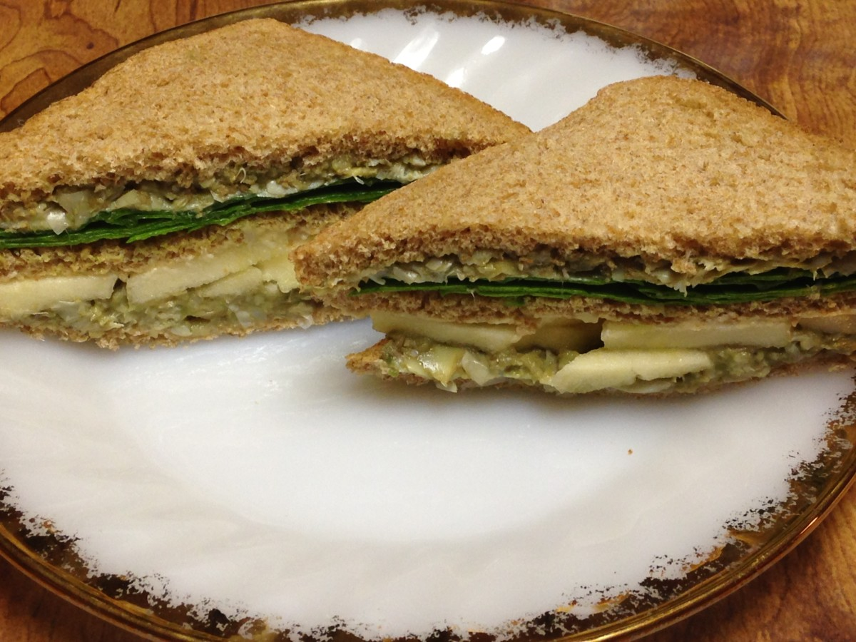 Green Club Sandwich from Weight Watchers Make & Take Meals cookbook.  You'll need avocado, artichokes, hummus, Granny Smith apple, and spinach.