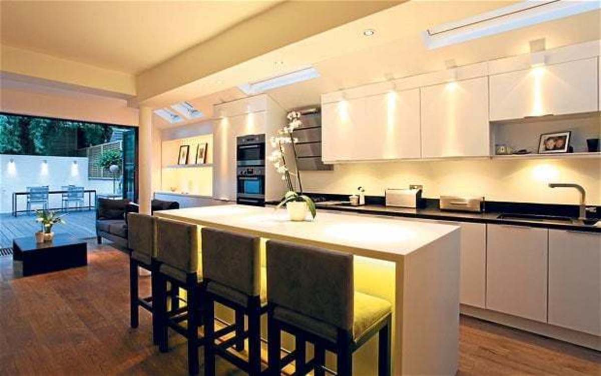 This kitchen is the layer of lighting in the great space.