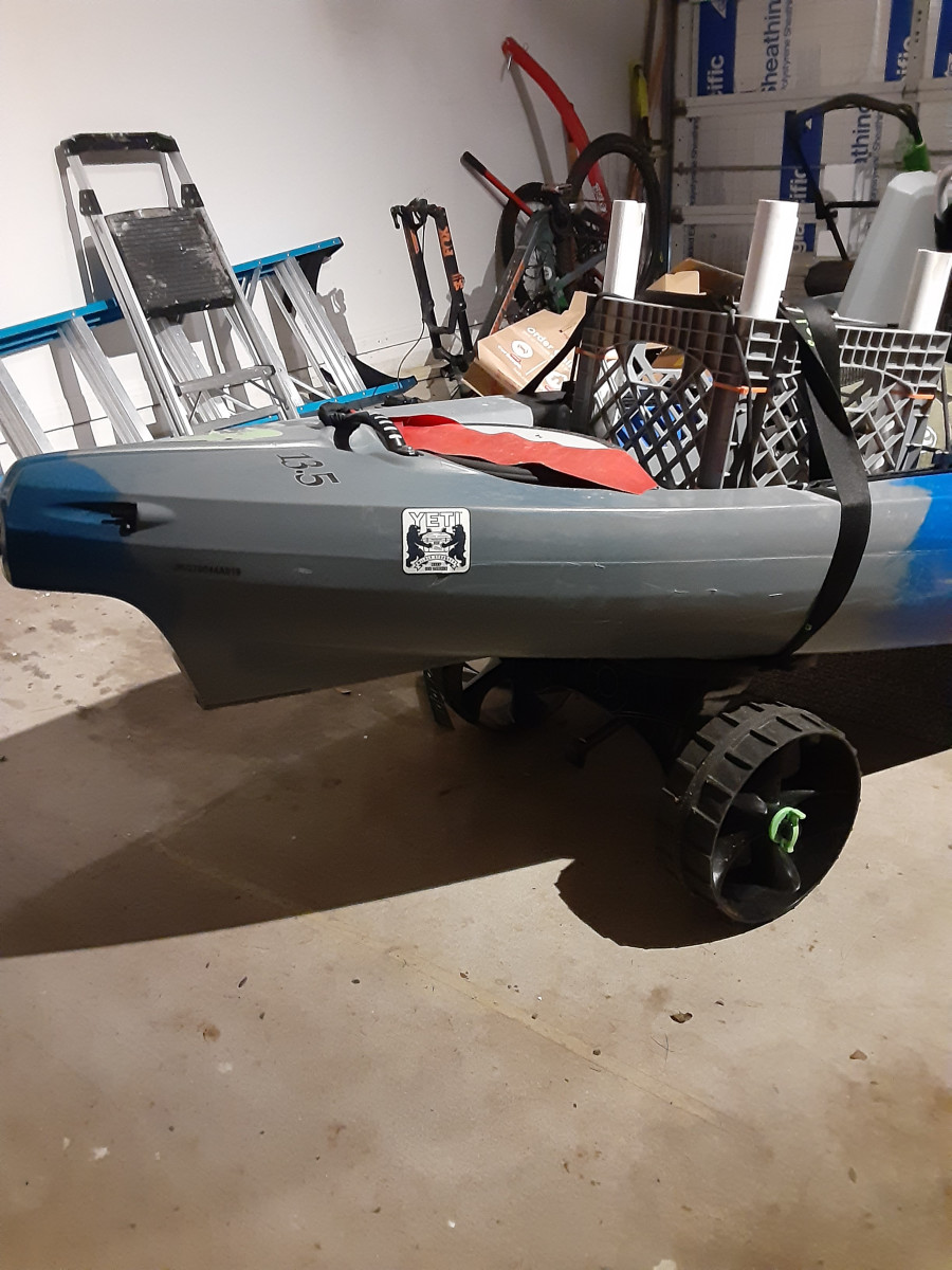 A C-Tug kayak dolly, kept in place even when storing the kayak so that it can be easily moved.