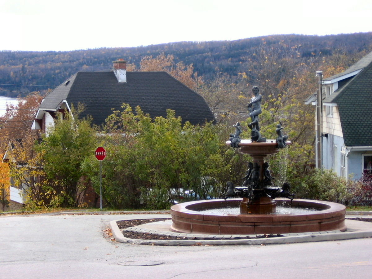 Ornate fountain in downtown Temiscaming, in view of surrounding forests