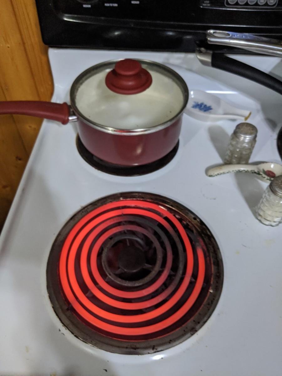 Literally switch burners - high heat to low heat