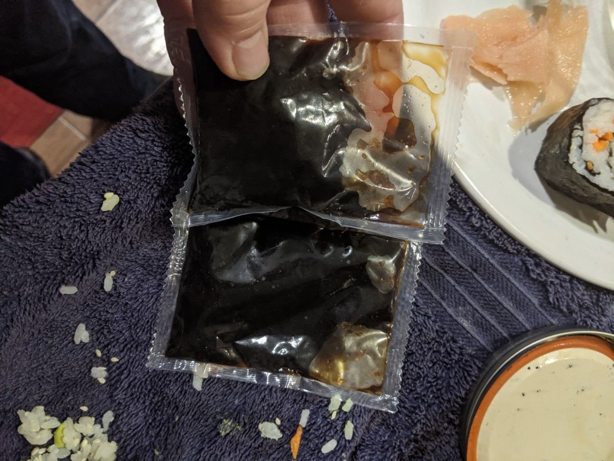 Packet of soy sauce into bowl for easy dipping