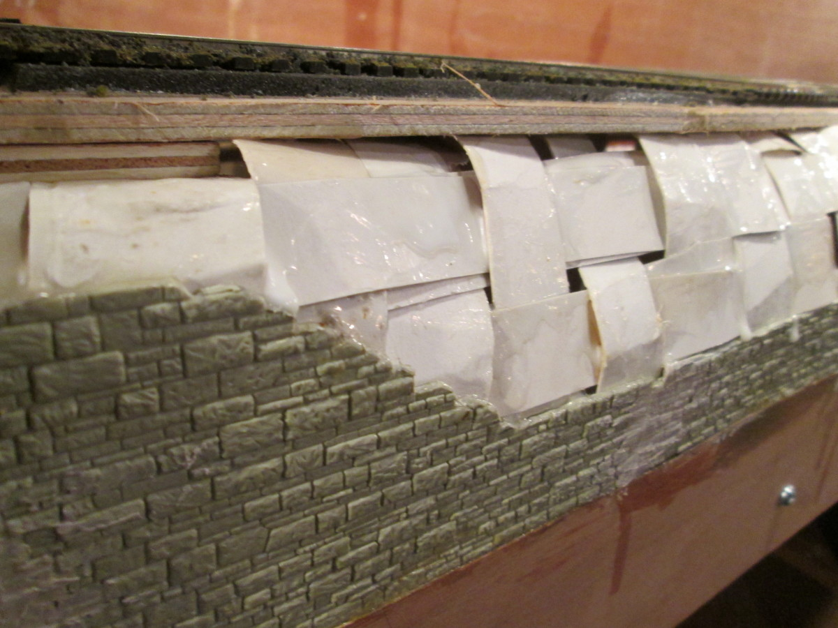 ... Beginning with vertical strips of card made pliable by bending, glued in place with strong wood glue, and adding horizontal strips over- and underlapped to strengthen the surface before I add 'Modoc', plaster impregnarted muslin sheet in strips