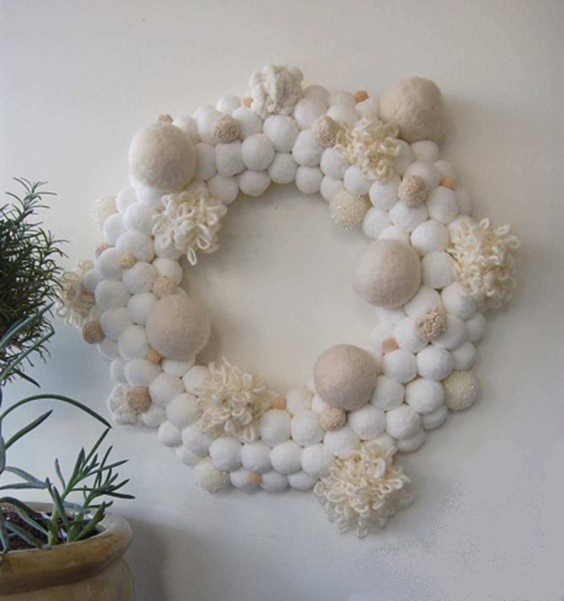 The very white and cream felted wool wreath.