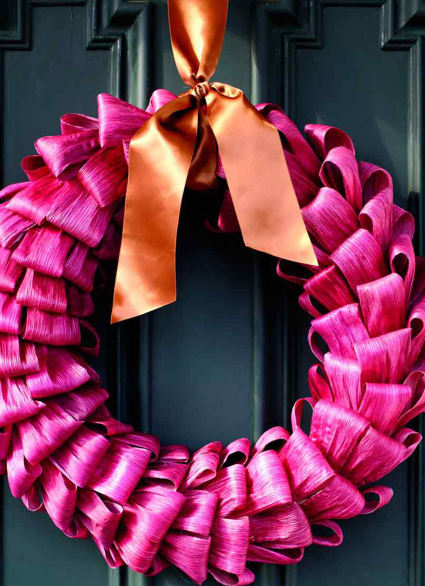 Richly dyed corn husks give a bold welcome to the season—perfect for color pink on the door. And for a party!