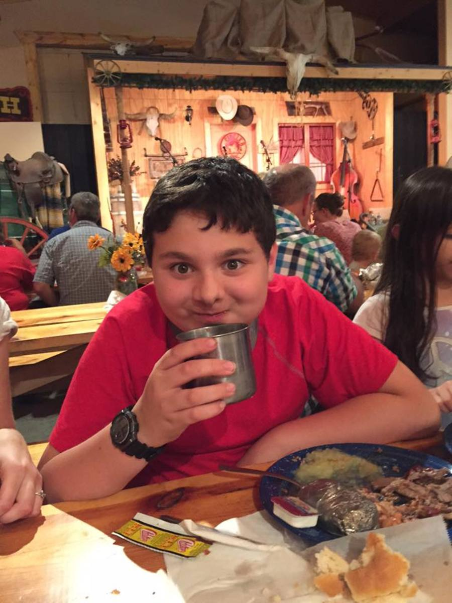 Our son Ben enjoys a lemonade at the Chuckwagon dinner