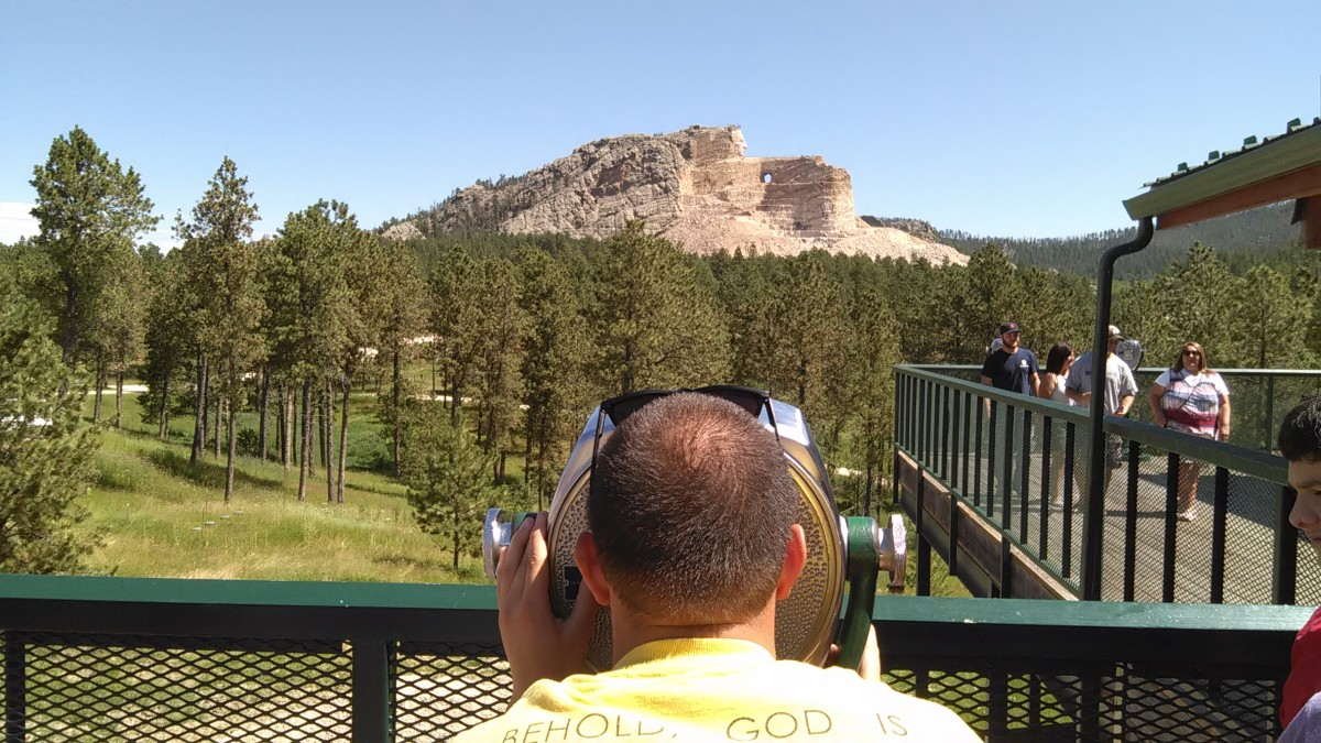 Our son Michael viewing Crazy Horse using a coin operated view finder