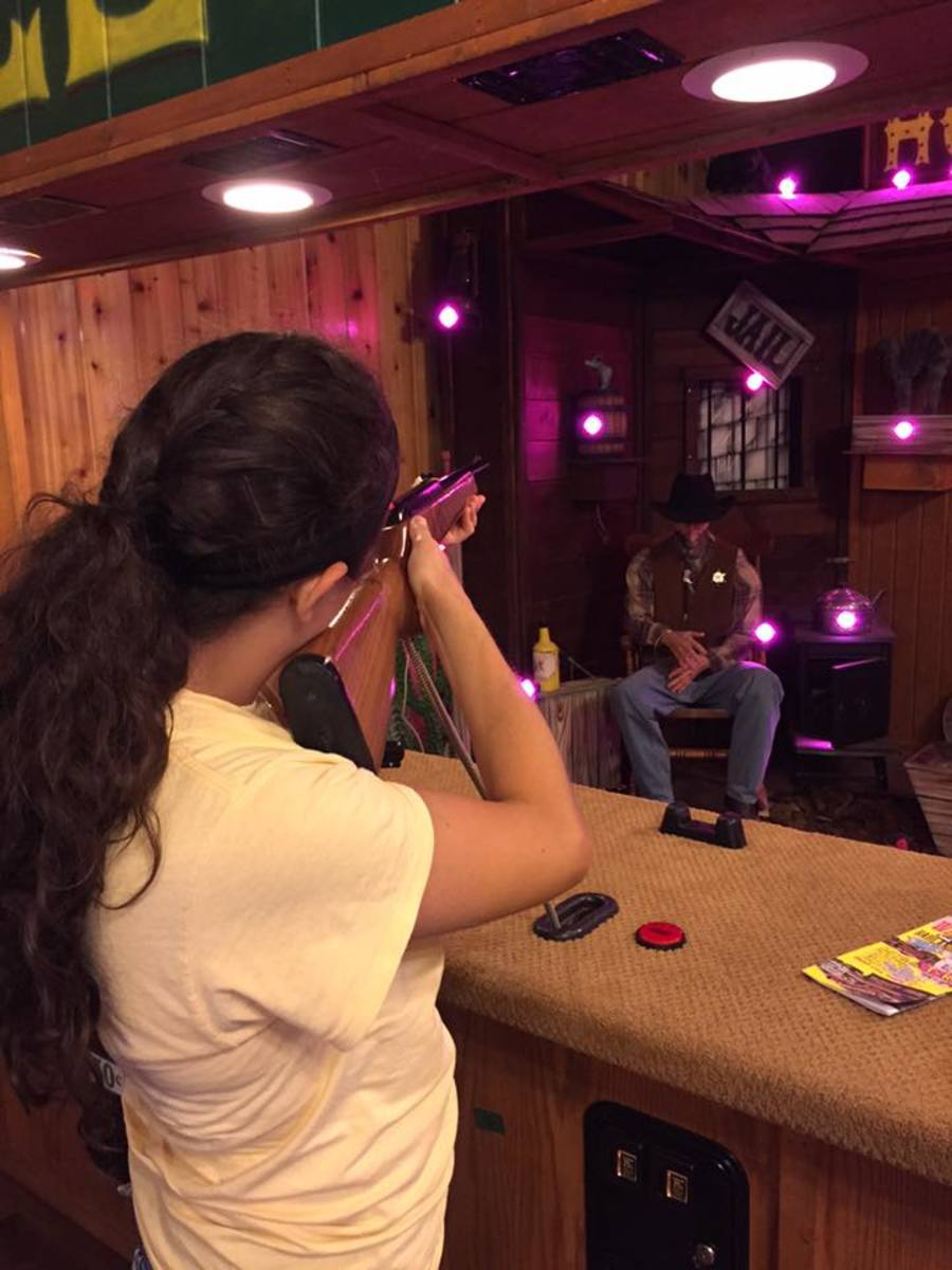 Our daughter Noelle at the coin-op shooting gallery