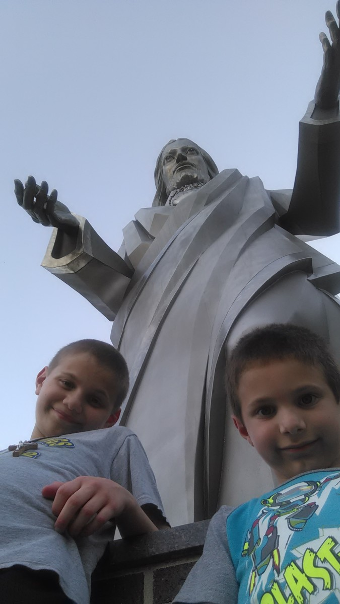 Statue of Jesus with two of our sons, Dominic (age 11) and Isaac (age 5)