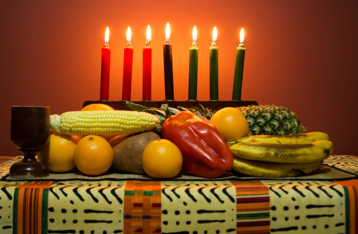 This Kwanzaa table displays an abundance of fruits of the harvest!