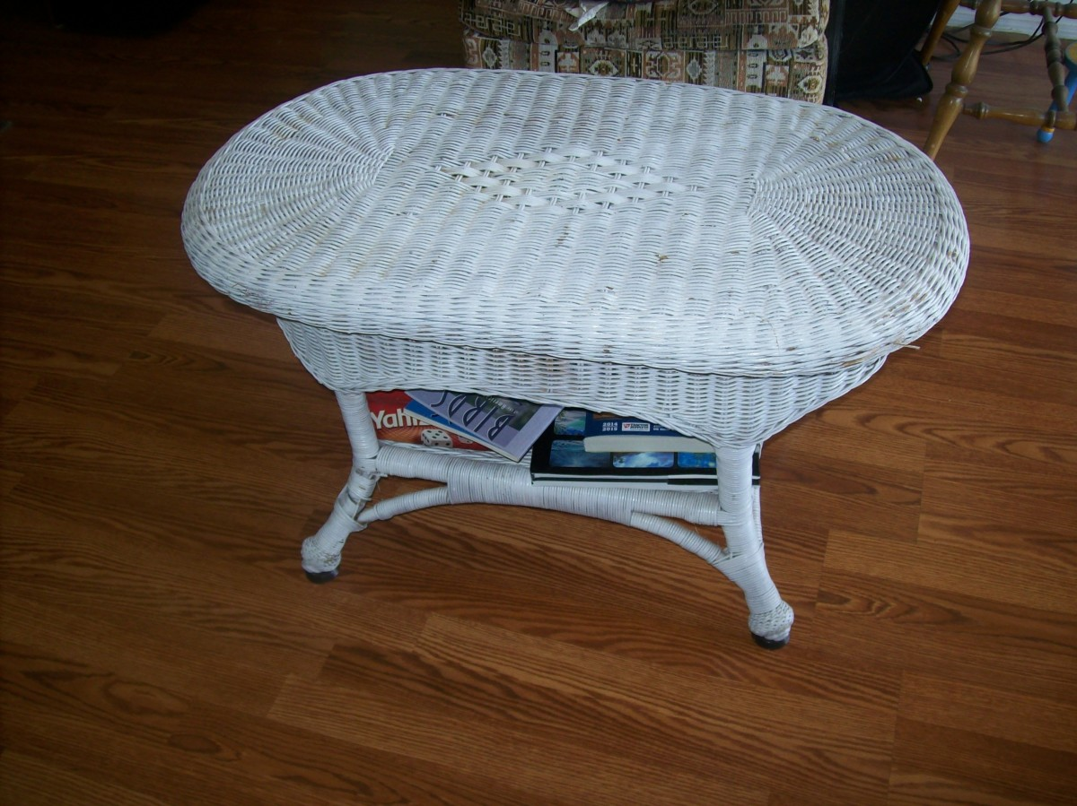 Wicker table that had a broken leg. Recovered from a dumpster. Cost: $3.00 for can of white spray paint and $1.00 for a small tube of epoxy.