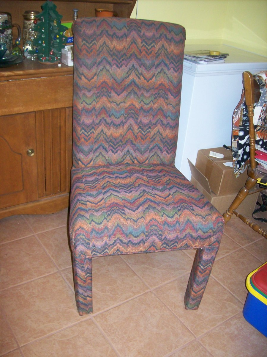 An upholstered chair, abandoned outside a restaurant with one broken leg. Cost: $1.95 small box sheetrock screws and 10 cents worth of glue. Oh, and elbow grease.