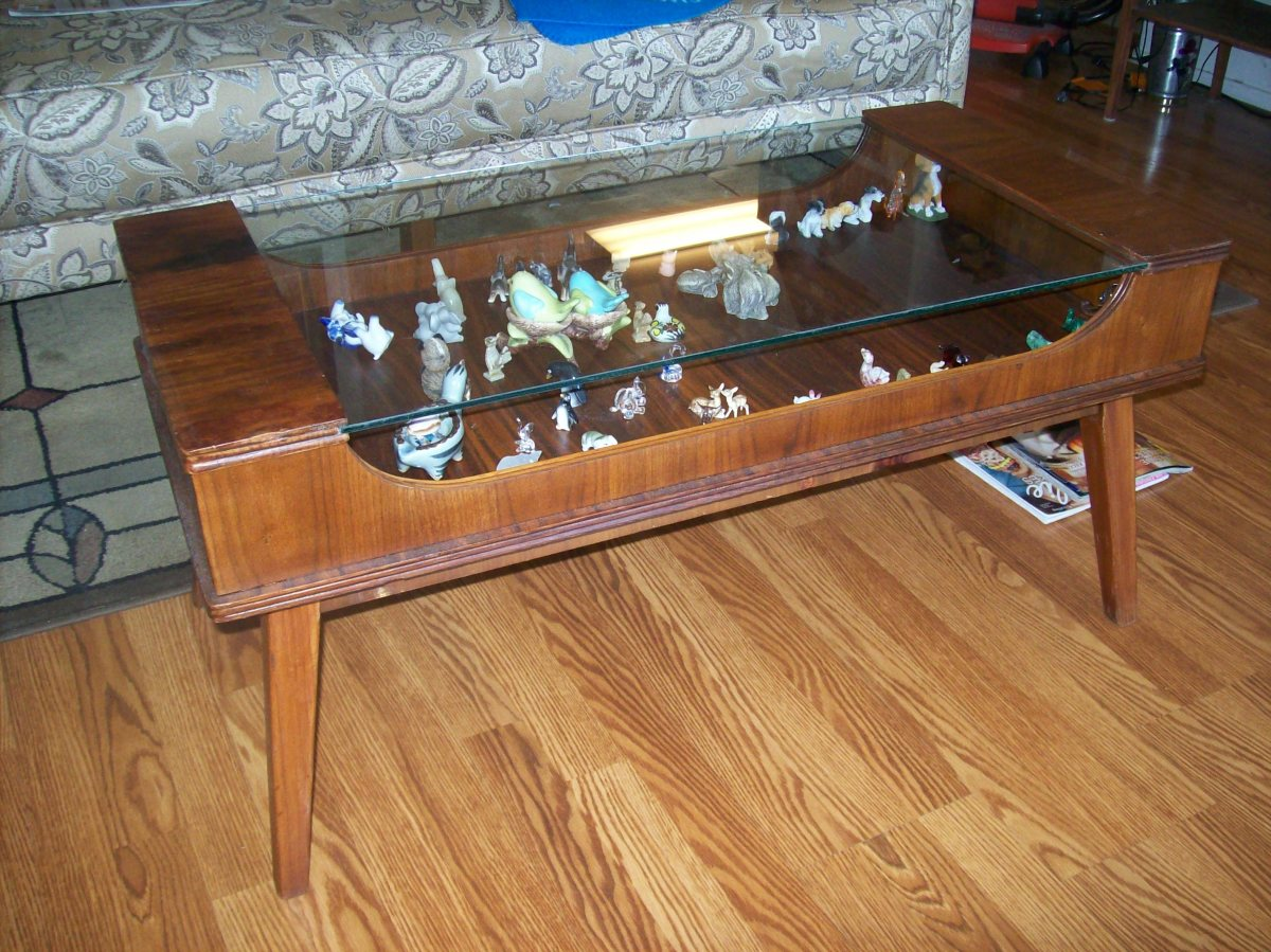 Grandma's coffee table that had been left outside. Cost: $2.50 small can stain and $2.50 small can of varnish. Oh, elbow grease, priceless.