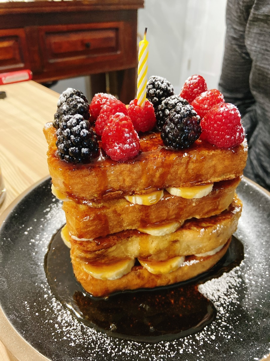 Ta-da! A French toast tower as a birthday cake for my husband. Four layers of eggy bread, sliced bananas, topped with fresh blackberries and raspberries. Yum!
