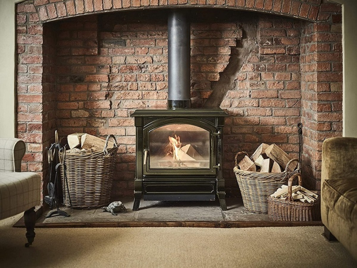 A wood-burning stove needs a firewood basket, and fireside tool set.