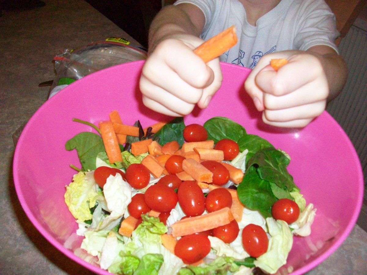 A beautiful green salad made by children's hands