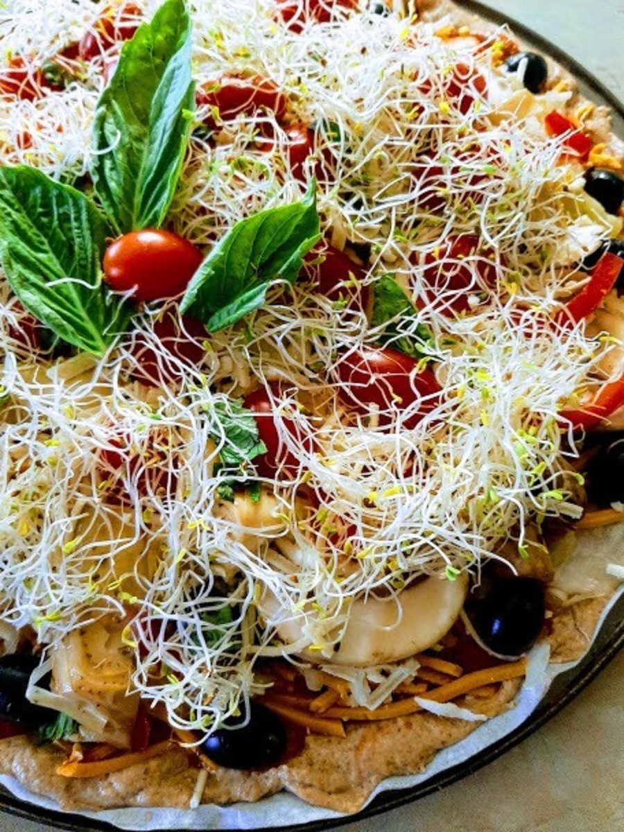 """Loaded vegan pizza ready to go into the oven.  Unkneaded spelt crust from recipe in """"Vegan Pizza: 50 Cheesy, Crispy, Healthy Recipes,"""" by Julie Hasson."""