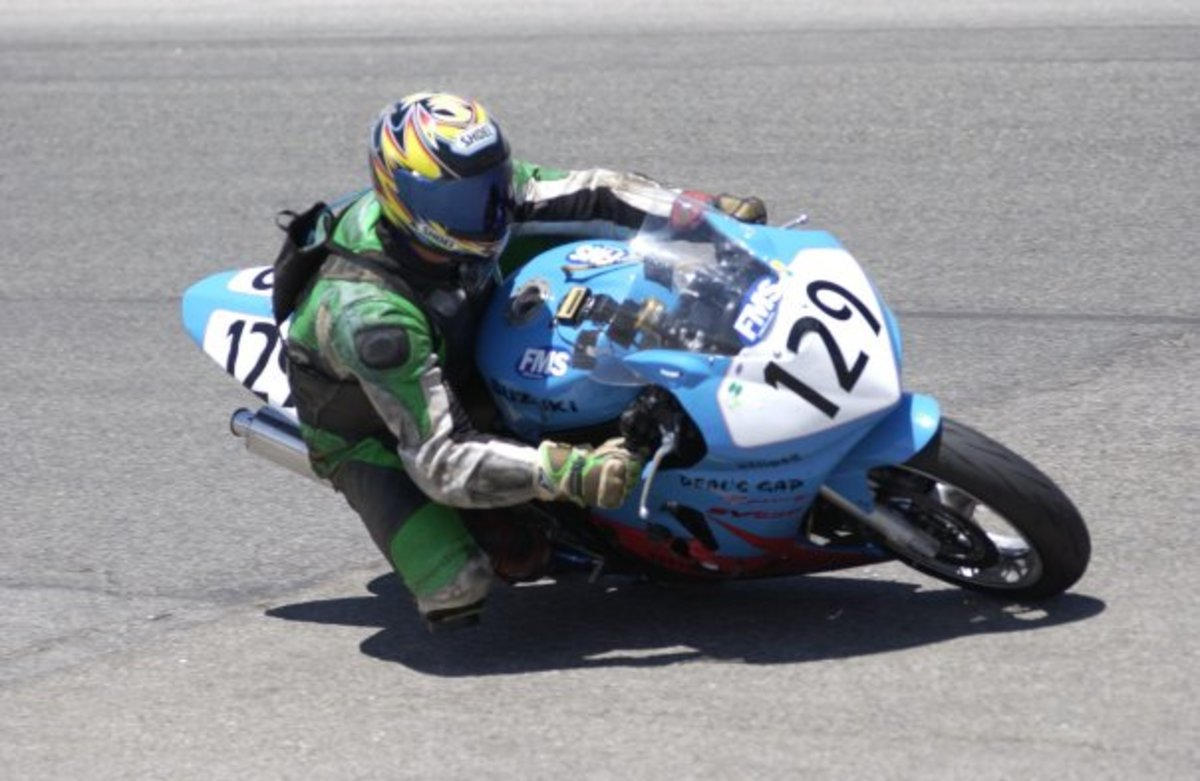 Steve Clark of Easy Bins Dumpster Rentals drags a knee around Willow Springs during a WERA National Endurance Race (circa 2005)