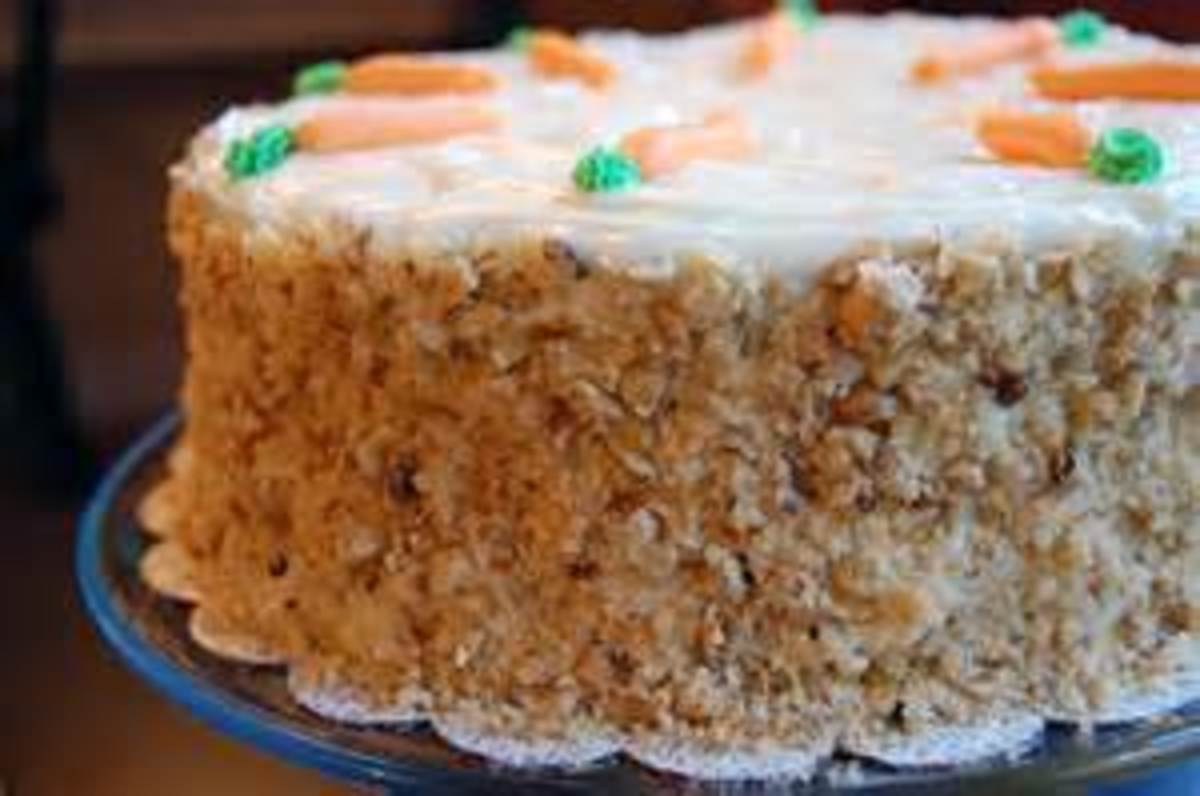 Bakery Carrot Cake decorated with crushed walnuts
