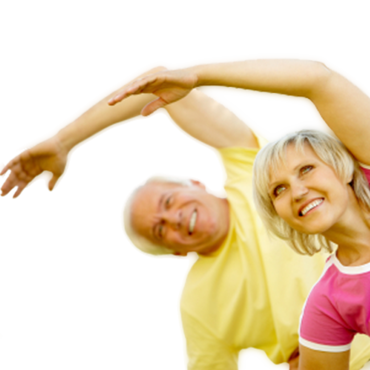 attractive senior couple exercising together - one in a yellow shirt and the female in bright pink with arms extended.