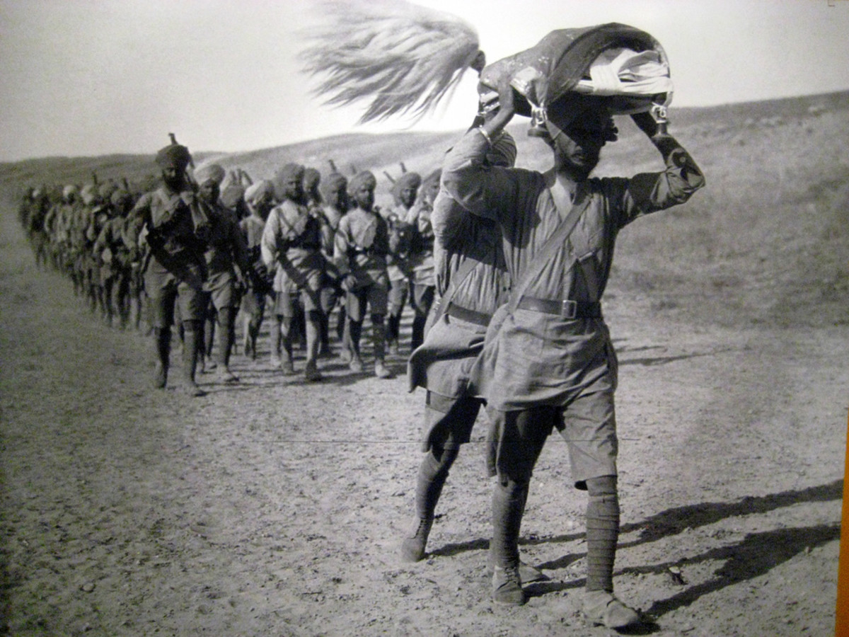 Sikh troops on the march carry the Guru Granth