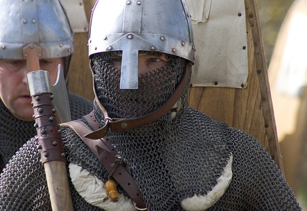 Only a knight with land and tenants could afford armour of this quality - Norman chain mail, helmet and weaponry on show