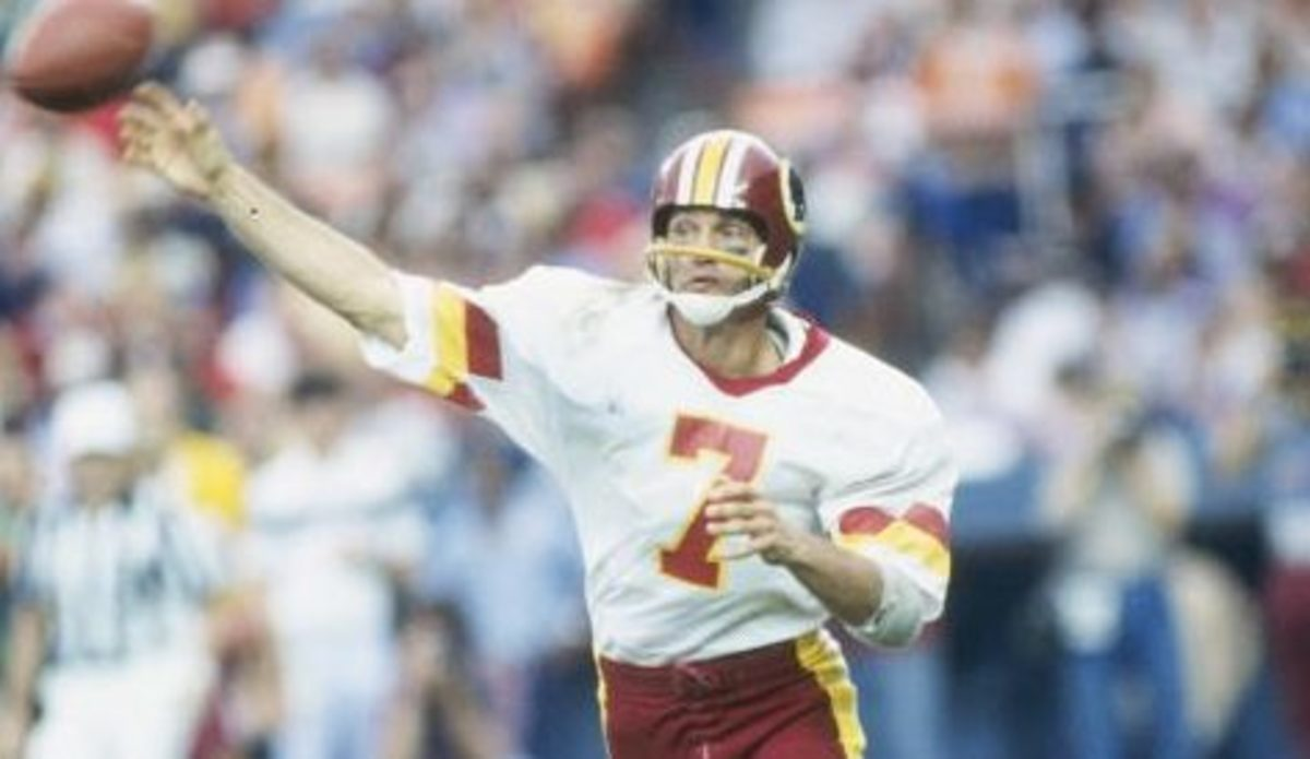 Theismann completed 14 of 23 passes for 264 yards