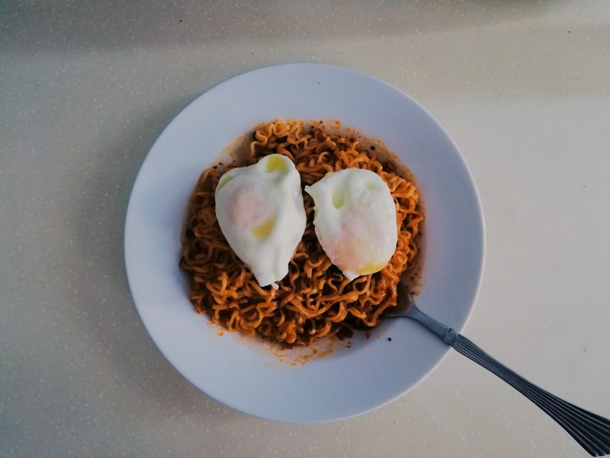 Poached egg on top of some spicy Korean fire noodles.