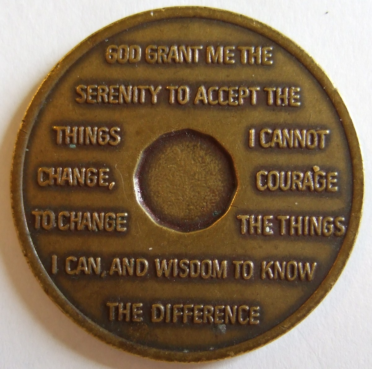 "Serenity Prayer on the back of an AA ""coin."""