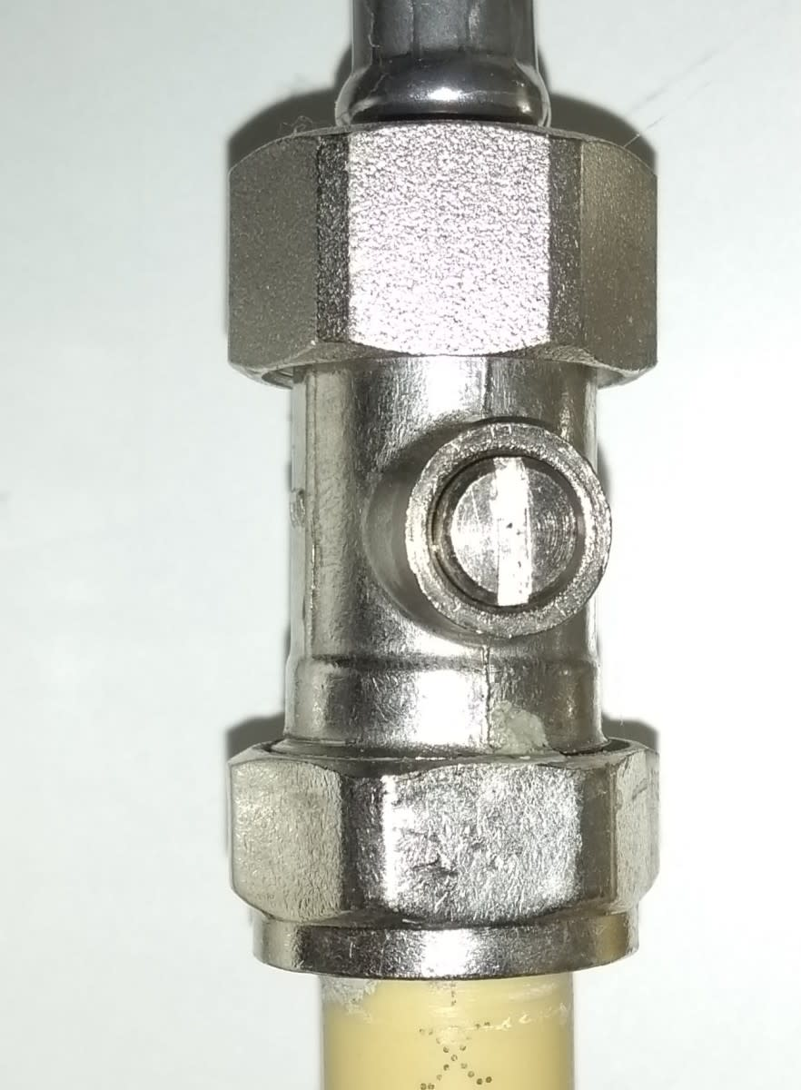 An inline isolating valve, often used for disconnecting water to individual appliances. Valves are turned on/off with a screwdriver. This valve is shown in the on position. Off is when the slot is turned through 90 degrees.