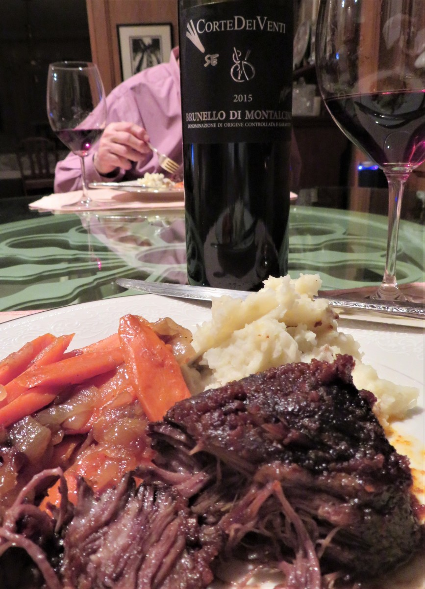 We are enjoying a delicious dinner of braised beef short ribs and accompaniments.