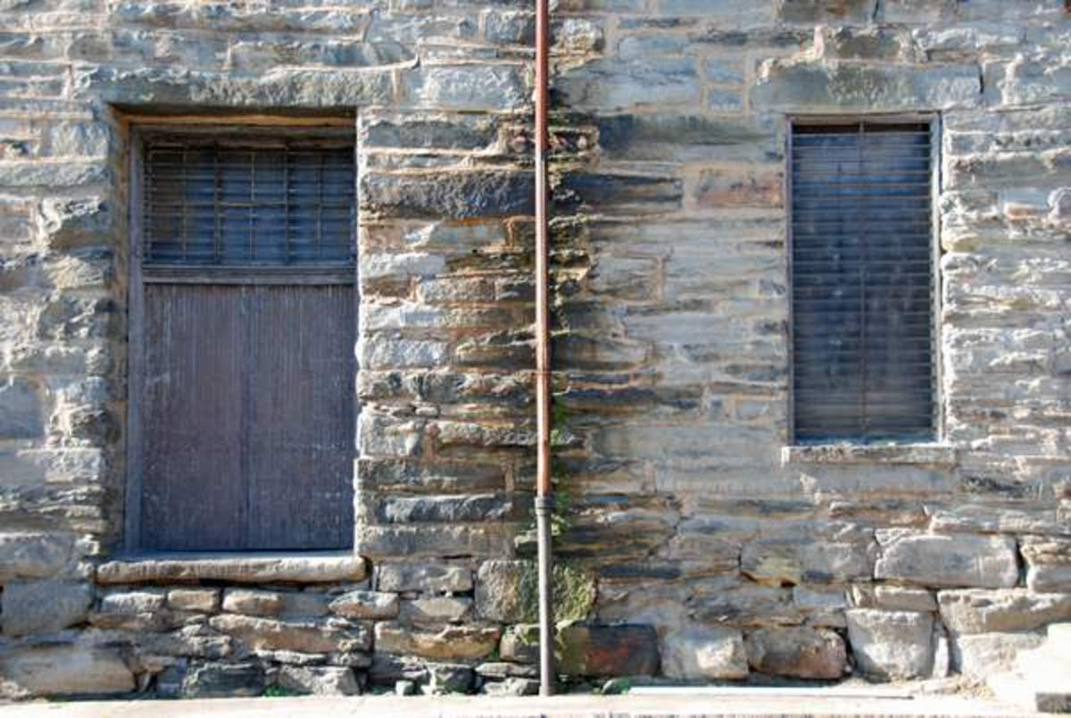 Windows, and Drains - Nature and Time has a way of coloring old stone that makes every wall a piece of art.