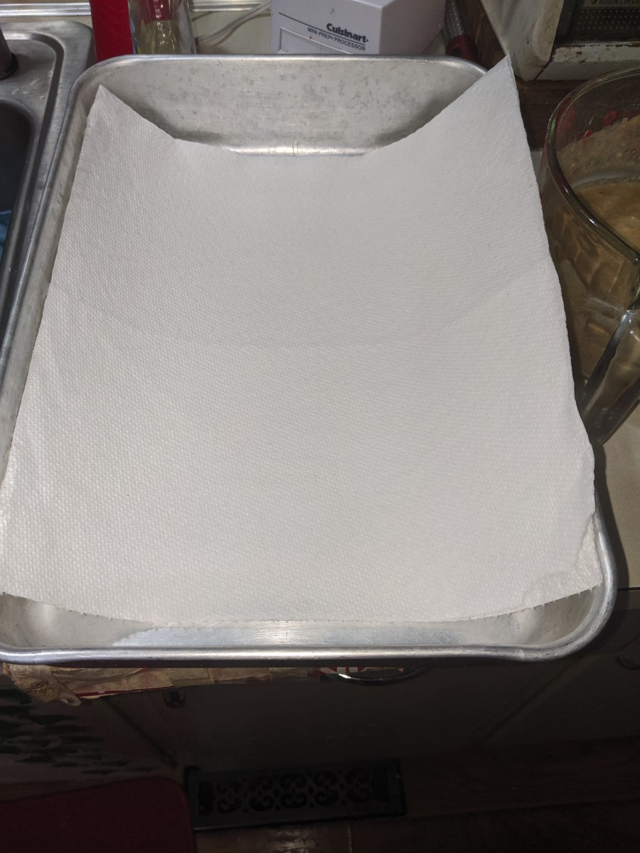 Line pan with paper towels