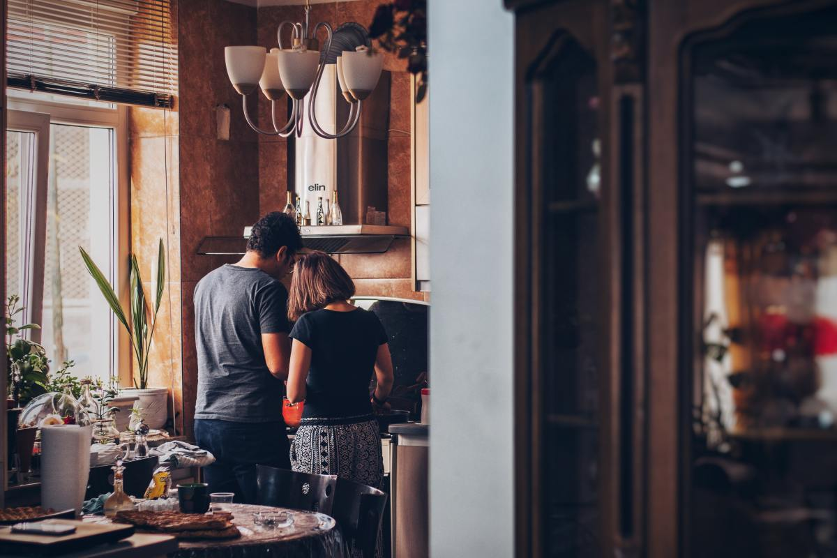 Cooking at home together right now will save money and give you both something to focus on that's not anxiety about the future.