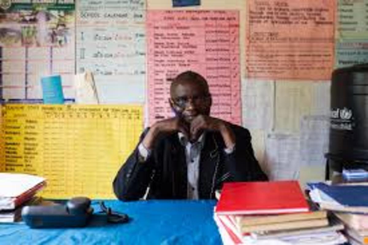 A head teacher at his office
