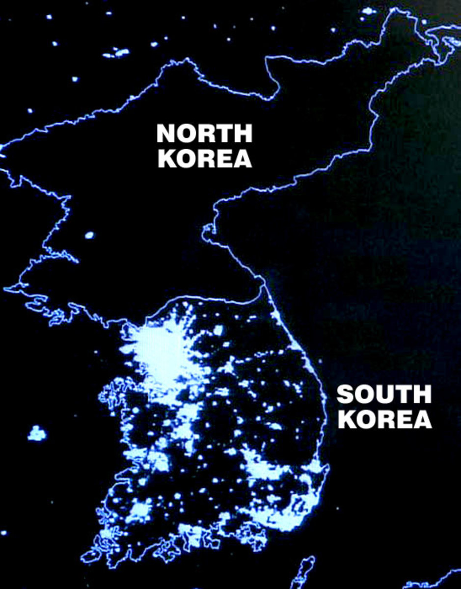 KOREA AT NIGHT; SOCIALIST NORTH POVERTY STRICKEN AND IN THE DARK; CAPITALIST SOUTH PROSPEROUS AND TOTALLY ELECTRIFIED