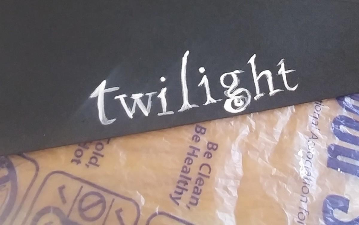 Paint twilight title on black foam sheet.