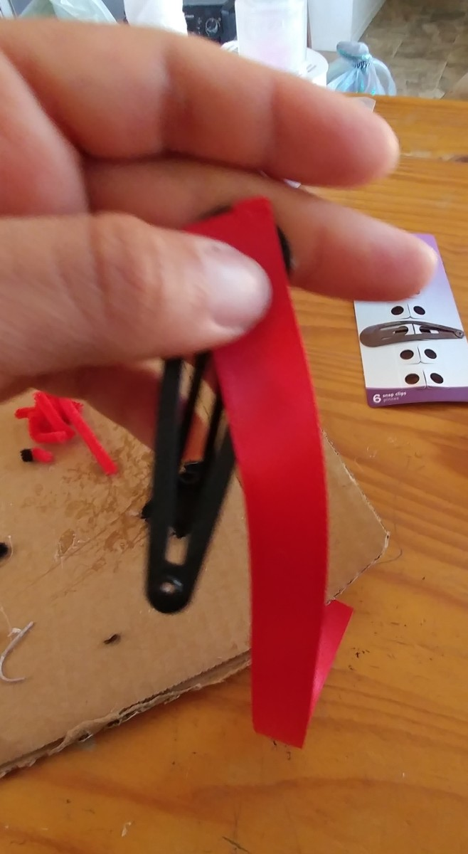 Glue red ribbon onto the top of clip.