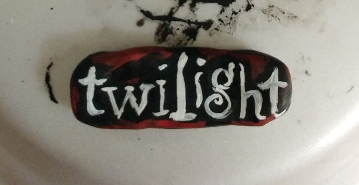 Paint the Twilight title onto clay. Shadow around title with red paint.