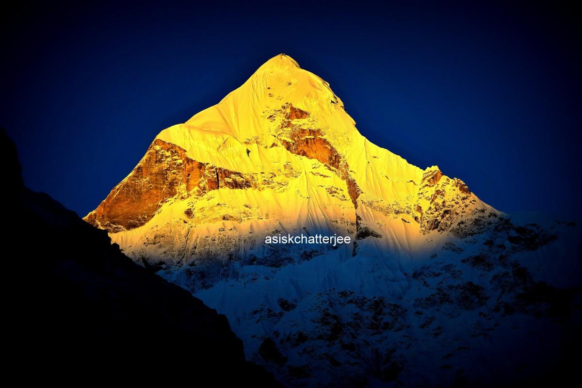Mount Nilkantha; co-ordinates 30.7299 degrees North, 79.4042 degrees East.