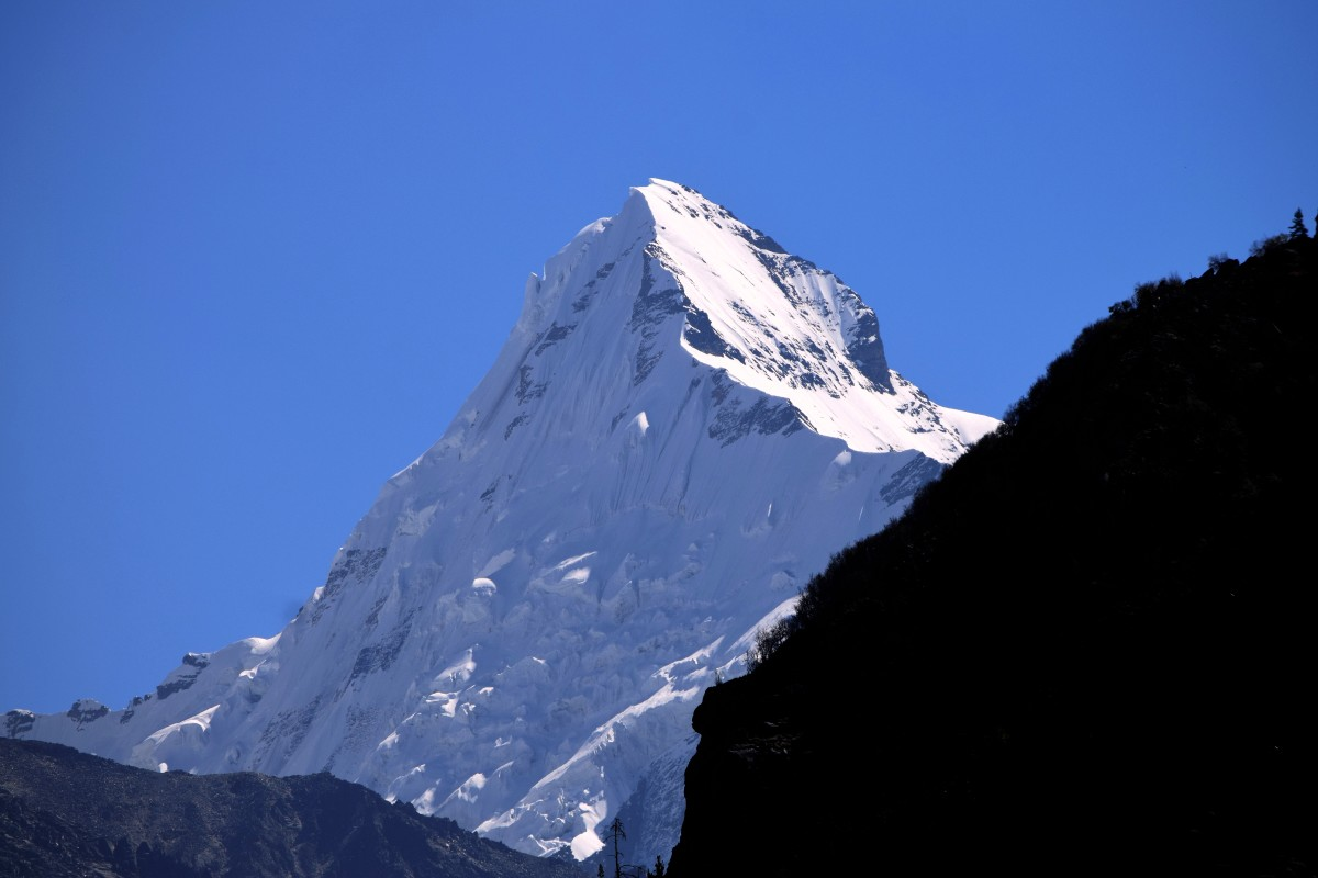 Mount SUDARSHAN : 30.9769 degrees North, 79.0933 degrees East.