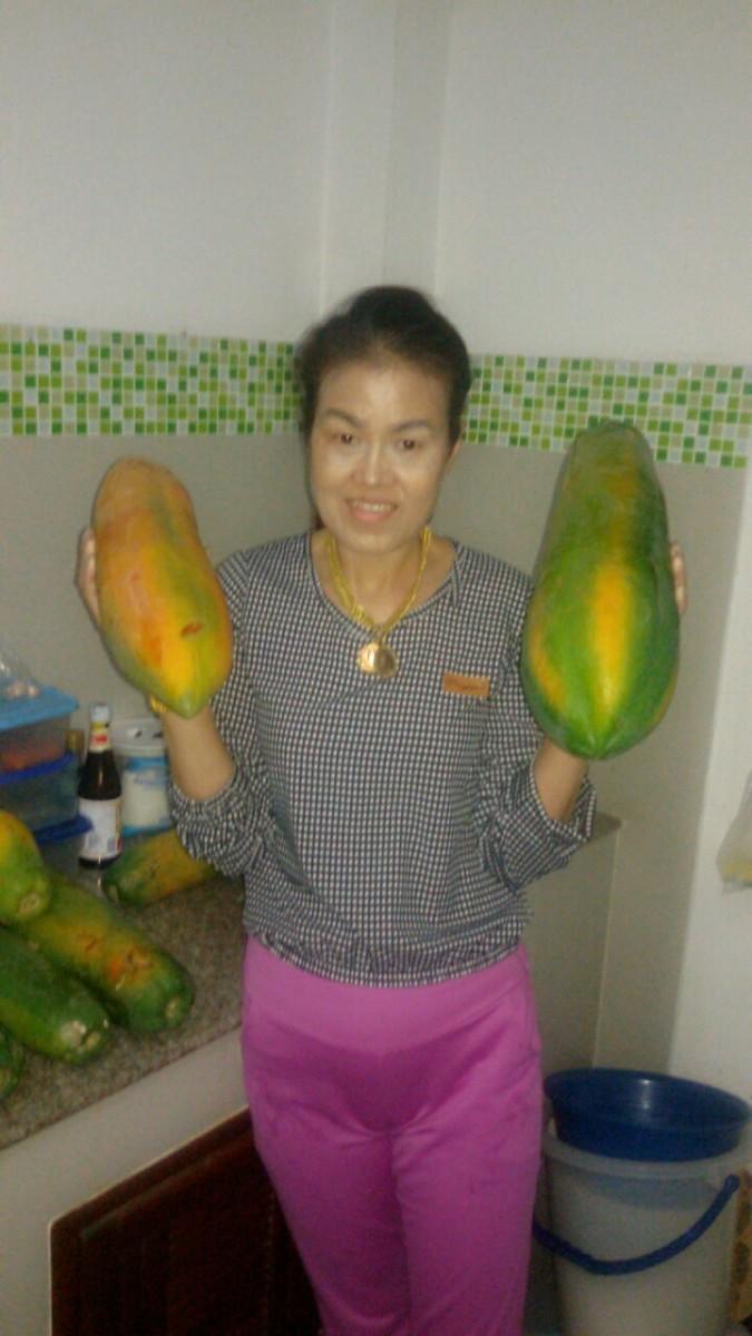 My wife with ripe papaya