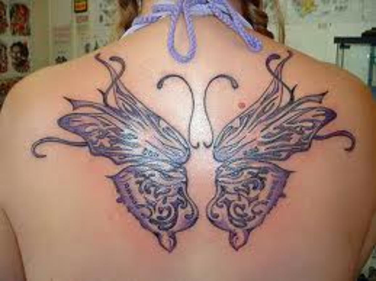 This butterfly is a beautiful design. It is in a spot that can be hid if need be.