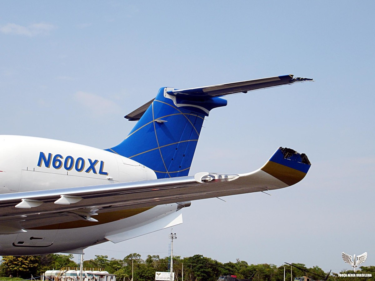 Damaged left wing and horizontal stabilizer of the Embraer Legacy jet