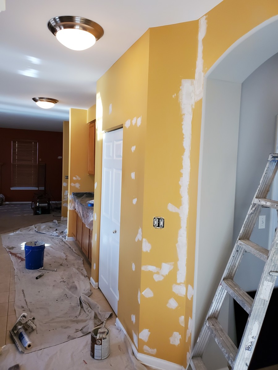 Prepping and painting a kitchen.