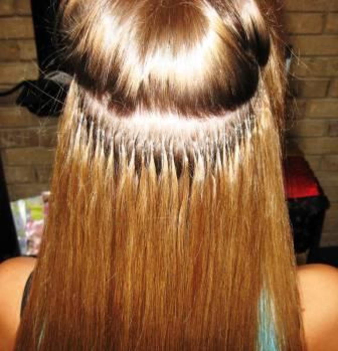 The fusion method of applying hair extensions.
