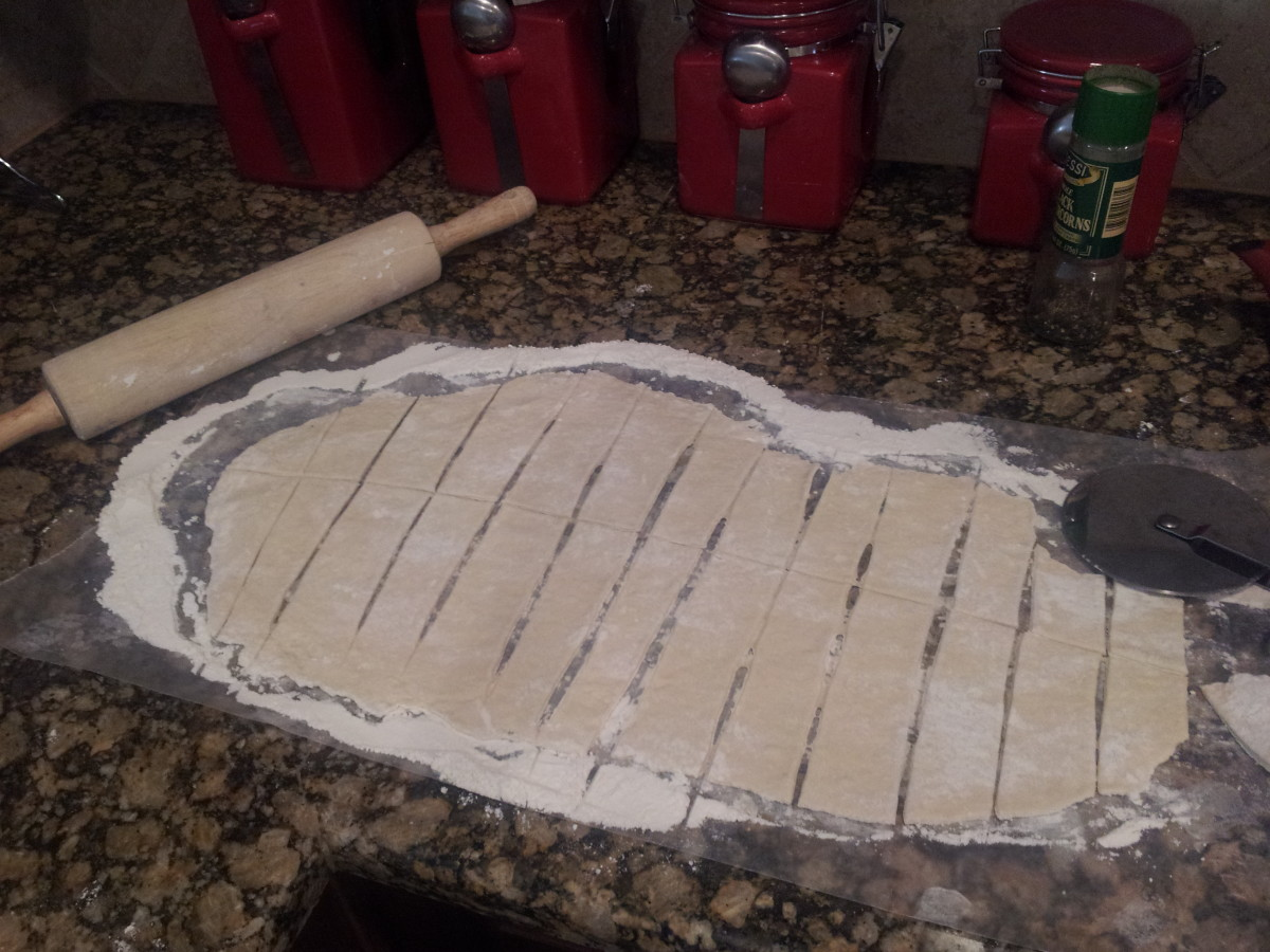 After rolling the dough to 1/4 of an inch thick, use a knife or pizza cutter to slice the dough into uniform pieces.